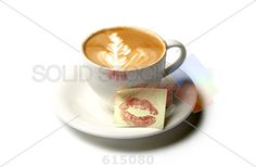 stock photo of cup of barista coffee with kiss note