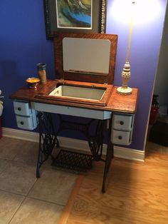 Our latest redo. Antique Singer sewing machine transformed into a Vanity!!