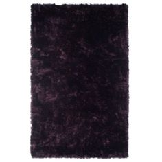 @Chesare Bullock, this area rug for that large area in front of your bed.    Indochine Rug - Aubergine from Z Gallerie