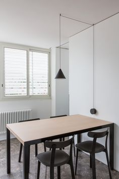 Natural Light and Neutral Finishes Define a Studio DiDeA-Designed Apartment in Palermo Vitra Chair, Interior Exterior, Interior Design, Study Rooms, Iron Table, Bespoke Furniture, Interior Lighting, Wall Lighting, Apartment Design