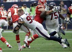 Houston Texans' J.J. Watt (99) sacks Kansas City Chiefs' Alex Smith (11) during the first half of an NFL football game Sunday, Sept. 13, 2015, in Houston.