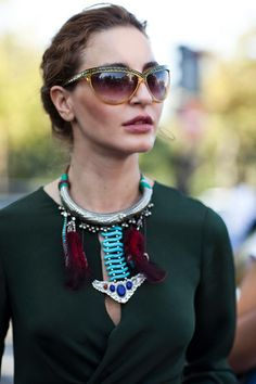 the cut of the blouse, the sunglasses and that amazing necklace