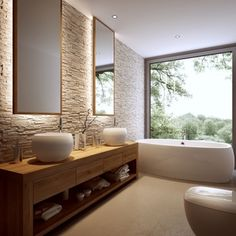 Dużęj rodzinnej łazience szyk nadaje ściana wyłożona kamieniem Roma Sahara.
