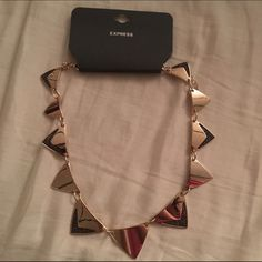 NWT Express Gold Arrows Necklace Has beautiful shimmery charcoal accents. Express Jewelry Necklaces