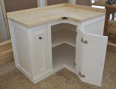 From Milestone Kitchens English Elegance Range. Custom Made Corner Unit with Spice Drawer and Doors.
