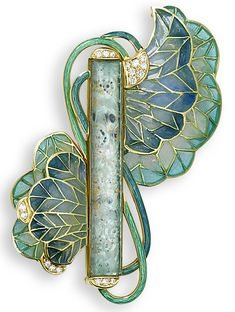 A plique-à-jour enamel and glass brooch, designed by Ivor Gordon. The central rectangular foiled eau-de-nil glass plaque by Lalique 1910, encased in a contemporary mount w/diamond terminals, issuing pale blue/green plique-à-jour enamel blooms to either side, w/brilliant-cut diamond highlights & entwined guilloche enamel stems, the central rectangular plaque signed Lalique, length 7.3cm
