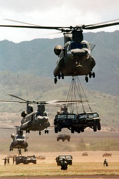 US Army Boeing CH-47D Chinooks taking off with underslung loads.