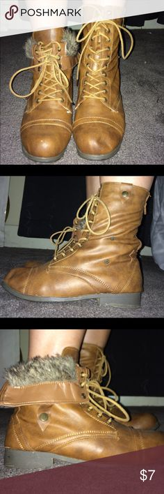 Combat Boots These boots are able to be flipped at the top to reveal the fur or you can just leave them rolled up. They are cute fall-ready boots. The brand is not printed on the boot. They were worn once. Shoes Combat & Moto Boots