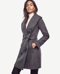 """In a rich doublefaced wool blend, our belted wrap coat looks as cozy as it feels. Oversize shawl stand collar. Long sleeves. Self tie belt. Vertical on-seam pockets. Lined. 37"""" long."""