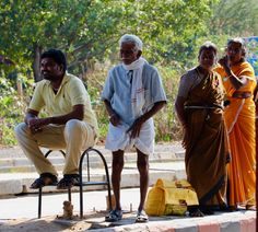 Life in India seems a lesson in patience…with a smile. Waiting for the bus at a toll plaza on the highway.