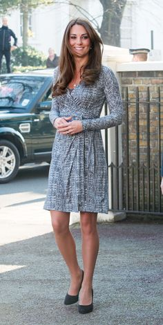 Kate Middleton returned to her royal duties when she made an official visit to Hope House in London earlier today. She wore a Max Mara wrap dress, which showed a hint of her growing baby bump. 2/19/2013