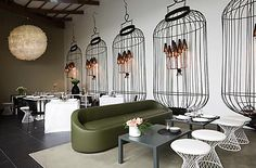 """Love these sconces, with painted """"bird cages"""" as accents."""