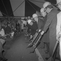 Black and white photograph of the ground breaking ceremony for the University of Scranton Weinberg Memorial Library, held on July 12, 1990.