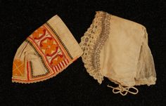 MORAVIAN KROJ or CZECH FOLK COSTUME, 19th-EARLY 20th C. Printed silk and wool skirt trimmed with red and yellow lace, navy apron with floral embroidery, tie dyed stripes and lace trim, brocaded vest in red, green, purple and yellow, embroidered blouse, three embroidered caps-two with beadwork and metallic threads, short sash