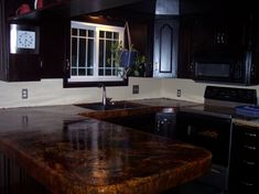 Stained concrete counter.   DIY kitchen remodel on a budget