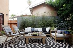 One of the challenges was coming to a home with a tiny patio. California is all about being outdoors, so I created a living room outside with rug and extra pillows.