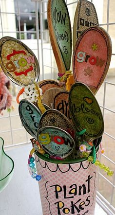 Plant Pokes: vintage silver and wooden spoons, alphabet letters, scrapbooking paper, glue, clear gloss spray, your imagination....place around you garden