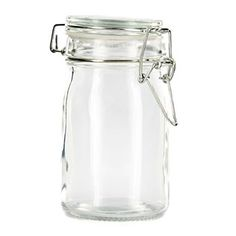 "Add subtle country-chic flair to your kitchen or craft supply storage with this Medium Glass Jar with Glass Lid & Metal Clasp! The jar features a smooth exterior and a tight-sealing harness top. Use it to hold small quantities of sugar, hot chocolate powder, beads, jewelry findings, and more!    	Dimensions:    	  		Width: 2 1/2""  	  		Height (With Lid): 4 3/4""      	Food safe. Hand wash only. Not microwave safe."