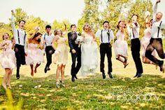 jumping bridal party fun wedding photo