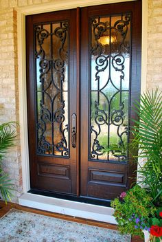 Chateau, rustic mahogany, entry door, custom entry doors, black grills, winterlake glass, composite entry door, custom wrought iron door