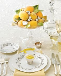 Glittered Faux-Lemon Centerpiece - A brightly hued citrus centerpiece, piled high with velvet leaves and silver balls, brings sophisticated cheer to an evening of Champagne toasts.