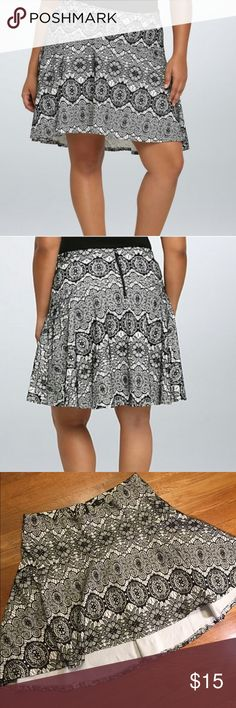Torrid black and white lace flare skater skirt This is a fun black-and-white skirt from torrid, black and white lace design, back exposed zipper, elastic waist, slight high low hemline. Waist 36 inches, and has some stretch, front link 17 inches back length 22 inches. See pictures for details. Be sure to check out other items in closet and bundle to receive discounts. torrid Skirts Circle & Skater