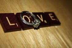 Scrabble ring@Heidi McGehee shot... Good idea for wedding albums or engagement pics!
