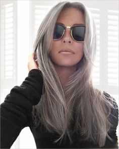 Grey.  Yes, this is her natural hair color....   It looks beautiful.   I can not wait until mine grows out completely! :D