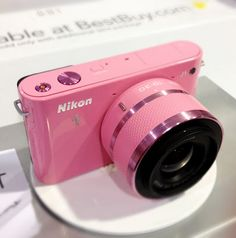 Pink Nikon camera.  #17holiday for Me!! but in blue(: