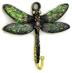 I actually have this on my wall and didn't realize it! - I paid a dollar at the thrift store.... said Shelly - Jeweled Dragonfly Wall Hook