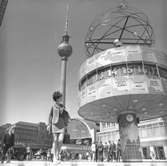 Woman at World-Time Clock at Alexanderplatz, Berlin in 1970.
