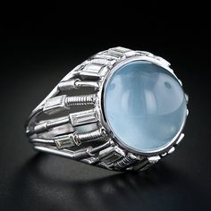 French Aquamarine Cabochon and Diamond Ring, 10.85 carat cabochon Aquamarine with 12 baguette diamonds, 0.75 tcw, VS-I1/G-H, 18 kt white gold, mind-20th century