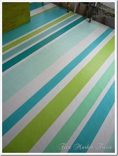 flea market trixie, painted floorcloth using back side of vinyl flooring.  Love the blue and greens