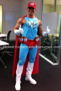 Coolest Duffman Costume-He used a size M blue v-neck Tee Shirt with the arms cut off and an XXL Tee shirt of the same color used to make the pants (turned inside out, and slipped on sideways, then pinned at the back and between the legs, pinned, single stitched and cut then turned back the right way). Red cap, cape material corners folded and double stitched on front of shoulders. White paint on chest and old boots. Duff symbols printed for hat and letters cut out and stitched to chest.