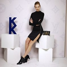 Pin for Later: The Stars Had a Party Inside Louis Vuitton's Monogrammed World Karlie Kloss Struck a Serious Pose, Proving Her Model Prowess