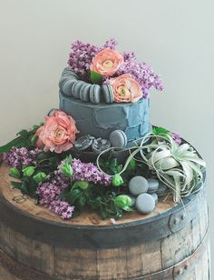 Flower + macaron topped gray cake