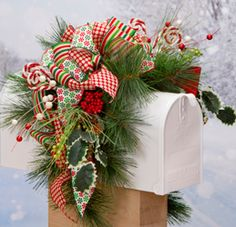 Adorn your mailbox with a Ribbon Mailbox Swag! It'll put everyone in the holiday spirits! Find all products at Pat Catan's!