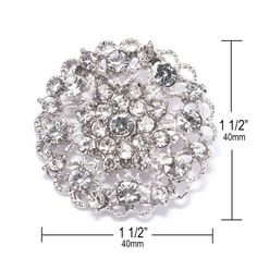 """PRODUCT OVERVIEW INSPIRATION CUSTOMIZATION Measurements Inches (Approx): 1 1/2"""" x 1 1/2"""" Measurements Millimeters (Approx): 40mm x 40mm Stones: Grade A+ CLEAR Glass Rhinestone Crystals Backing: Brooch Pin Metal Plating Color: Antique Silver  Some say secrets are those things you only tell one special person at a time. When your wedding is aglow with out-of-this-world crystals like this ornate rhinestone flower brooch people will ask, Where did she ge..."""