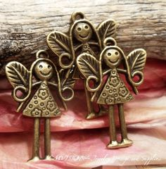 4pcs of Antique Bronze Lovely Smiling Fairy Charms by CMVision