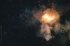 Exploding green firecracker  by Urs Siedentop & Co for Stocksy United