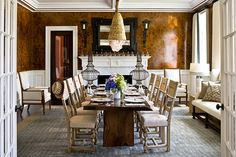 Marshall Watson designed this dramatic dining room for the 2009 Hampton Designer Showhouse. Custom caramel-colored walls give off a warm glow next to contemporary furniture - Traditional Home®    Photo: John Bessler and Squire Fox