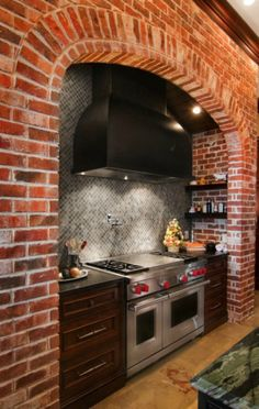 Wolf Range and Hood with 4 to 6 gas burners paired with griddle, charbroiler, or French top and double electric ovens with convection feature and broiler