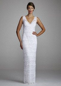 Traditional but exceptional, you are spectacular in this dress. Beaded stretch lace sheath features tank bodice, surplice v-neckline. Floor length skirt features slit in back. Hand wash. Fully lined. Available in White. A form fitting gown that contours to your natural silhouette.