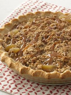 Extra Easy Caramel Apple Pie with a crunchy pecan topping. A dessert that will impress!