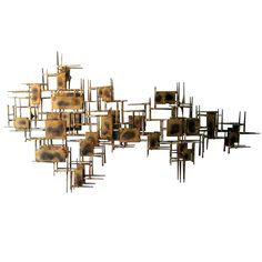 A mid century modern brass wall sculpture | From a unique collection of antique and modern wall-mounted sculptures at https://www.1stdibs.com/furniture/wall-decorations/wall-mounted-sculptures/