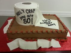 """Over the Hill - 9 x 13 iced in chocolate fudge buttercream. 5"""" toilet paper roll wrapped in fondant."""