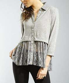 Worn over skinny denim, this button-up top fronts serious vintage-inspired taste. Boasting a classic silhouette and feminine lace hem, it's a charming closet essential.