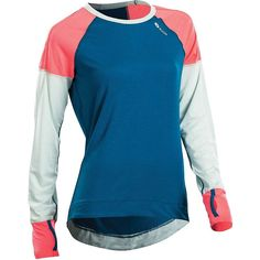 Sugoi Coast LS Top - Women's Baltic Blue Large. Dri Active Jersey is an ultra soft, moisture wicking knit material. Thumbholes at cuffs add coverage and help keep hands warm. Flatlocked reflective seams.