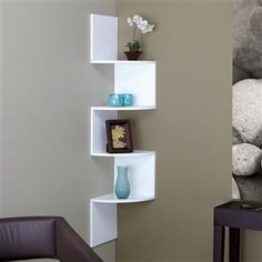 This shelf is great to store books and stuffed animals - even the baby monitor!