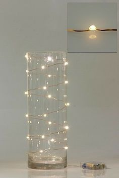 Hang this lamp above or put it on the dinner table for a flickering effect on your wedding reception. Visit http://balieventstyling.com for more lighting styles.